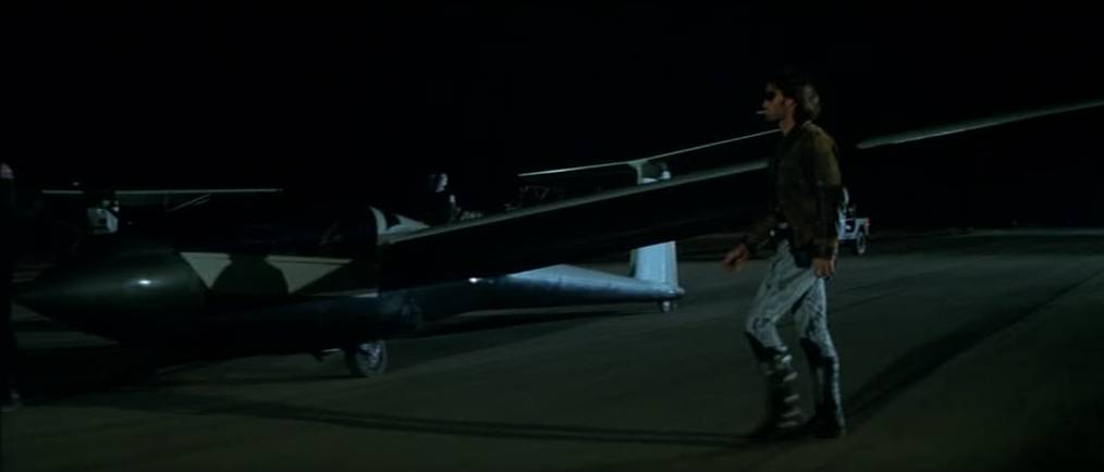 Snake prepares to fly the glider