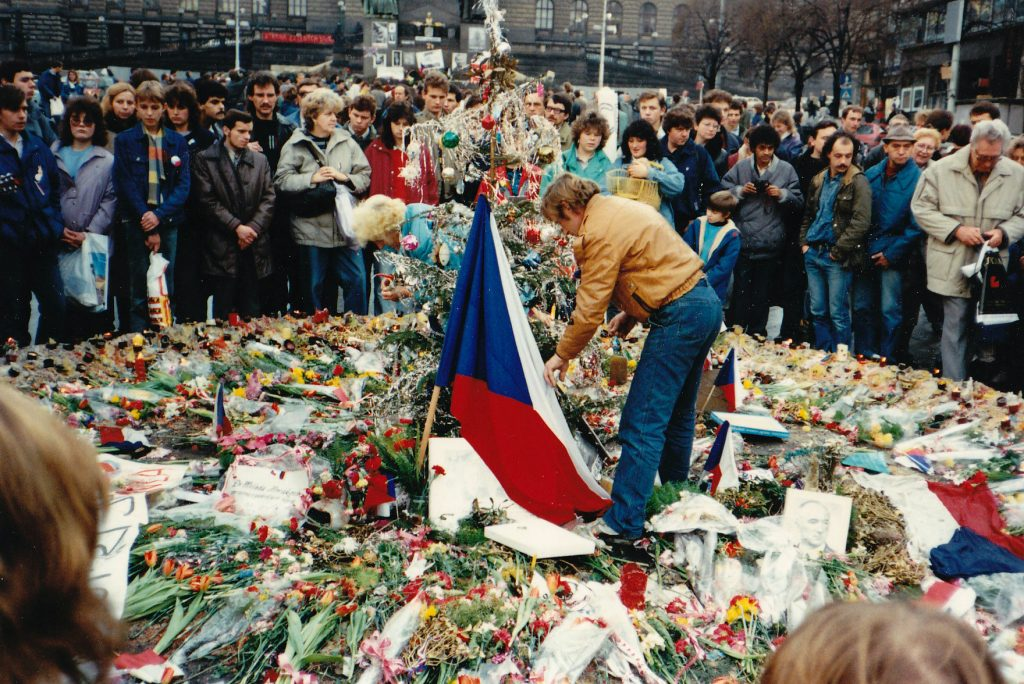 Havel laying flowers for victims of police brutality during the Velvet Revolution.