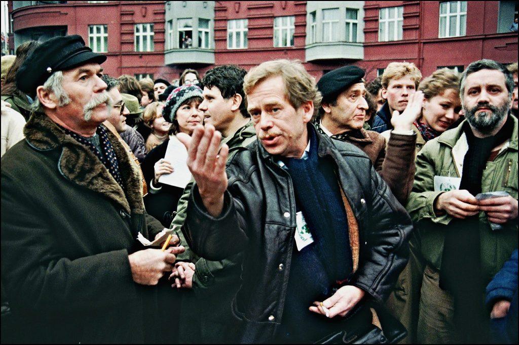 Vaclav Havel (center) walks with Charter 77 members Ladislav Lis (Left) and Rudolf Batek (2nd right) while leading marches during the Velvet Revolution