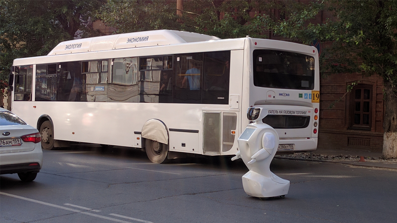 Escaped robot blocking traffic in Russia.