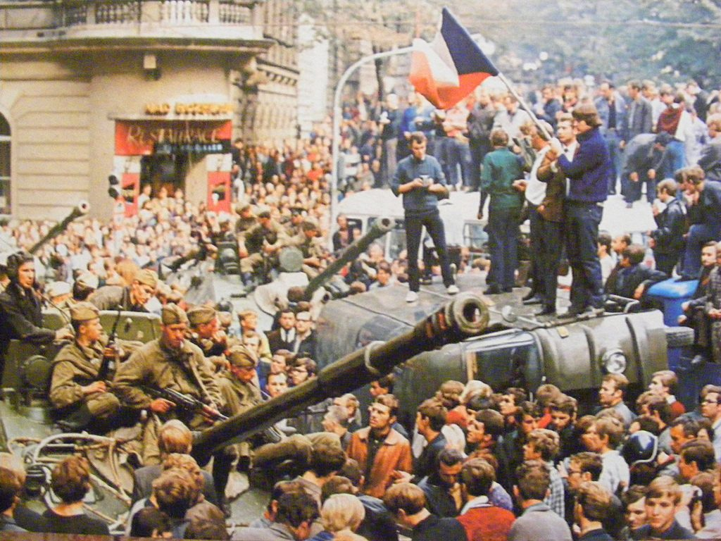 Czechs block a unit of Soviet soldiers from moving further into the city during the Prague Spring (1989).